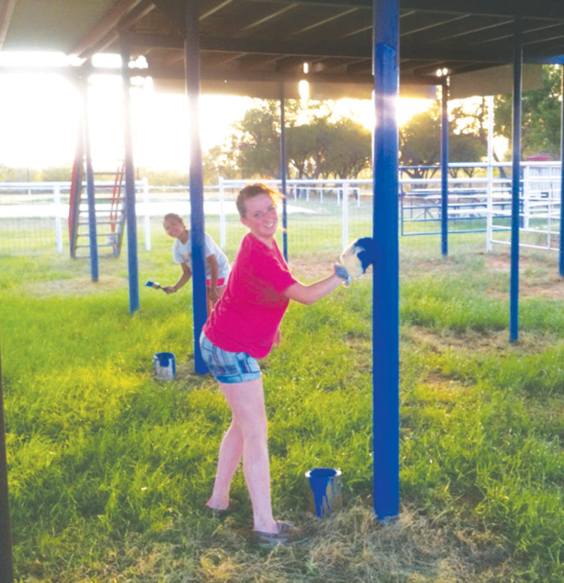 These pretty girls, Sirbina Salazar (background) and Emalee Rice (foreground), are helping to spiff up the grounds at the Atascosa Showbarn Arena in preparation for the Pleasanton Young Farmers Cowboy of the Year Rodeo Festival. The fun begins Friday night and lasts until Saturday night. Gary P. Nunn will perform on Friday after the rodeo and Steve Wariner will perform on Saturday. Barbecue cook-off, washer tourney and welding rig contest are planned for Saturday during the day.