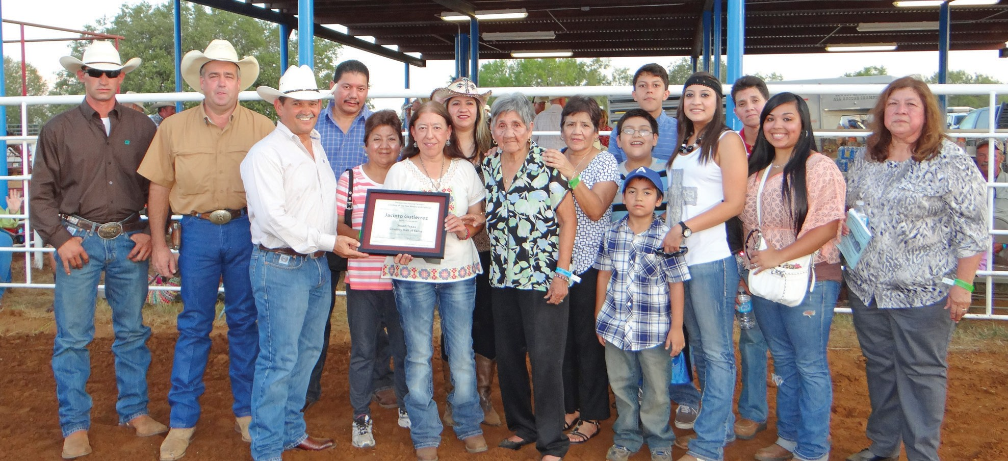 The family of Jacinto Gutierrez, Jr. gathered to honortheir father and grandfather's posthumously induction into the South Texas Cowboy Hall of Fame during the Pleasanton Young Farmers Cowboy of the Year Rodeo and Festival held this past Friday, August 16. From left are Pleasanton Young Farmers Dustin Neal and Randy Rice (PYF President) and Joel McDaniel 1990 Cowboy of the Year and Selection Committee Chair who presented the certificate to the family, (from left) Lupe Fernandez, Olivia Gutierrez, Mary Calvillo, Yolanda Murillo, Gloria Fernandez, Lydia Huntington, Evan Romero (in cap), Jade Romero, Pilo Calvillo, Stephanie Calvillo, Rachel Macias,Samantha Garza and Dora Barrera.