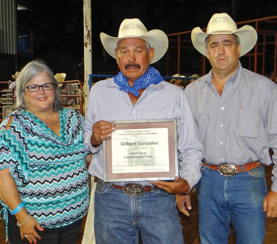 Gilbert Gonzales was inducted into the South Texas Cowboy Hall of Fame during the Pleasanton Young Farmers Cowboy of the Year Rodeo and Festival held this past weekend. From left are Pleasanton Express Editor Sue Brown, Gonzales and Pleasanton Young Farmers President Randy Rice. Gonzales was also the 1992 Cowboy of the Year.