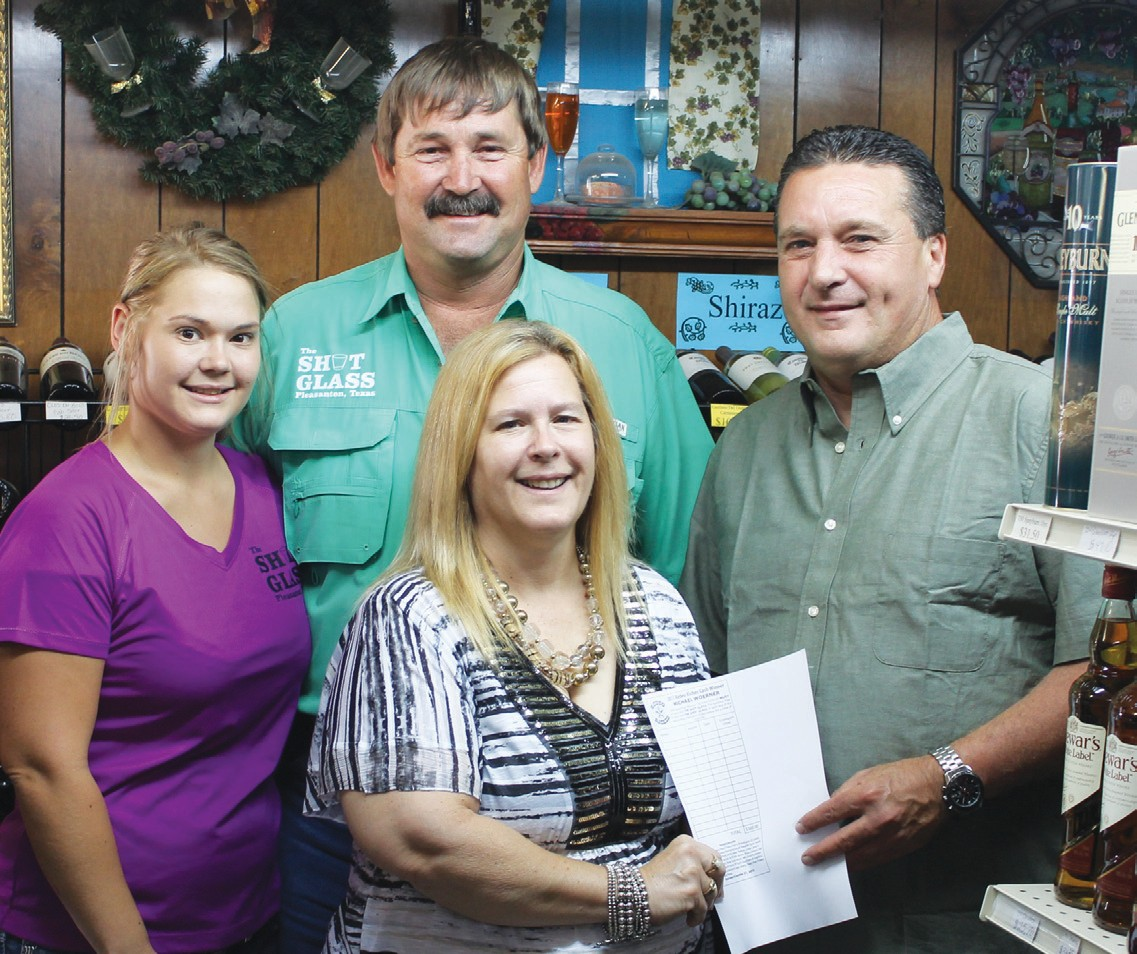Michael Woerner of Pleasanton won the grand prize of $500 of merchandise from Rodeo Riches by registering at The Shot Glass. Celebrating his winning entry are Kimberly Bosquez, Sharon LaGrange and Edward LaGrange owners of The Shot Glass.