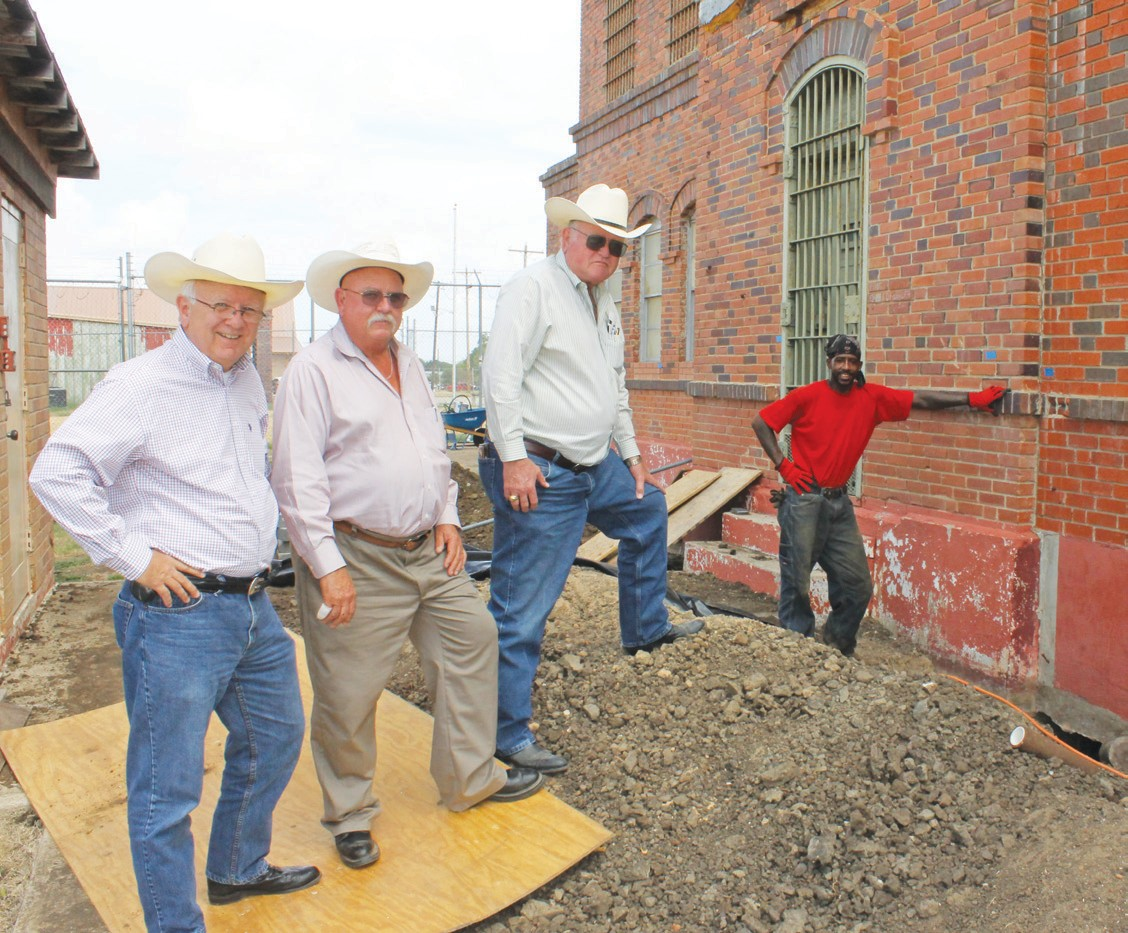 From left, Atascosa County Auditor Ray Samson, County Commissioner Lonnie Gillespie, Pct. 1, County Commissioner Bill Carroll and G. I. Hunt foreman, Rodrick Mitchell at old jail work project.