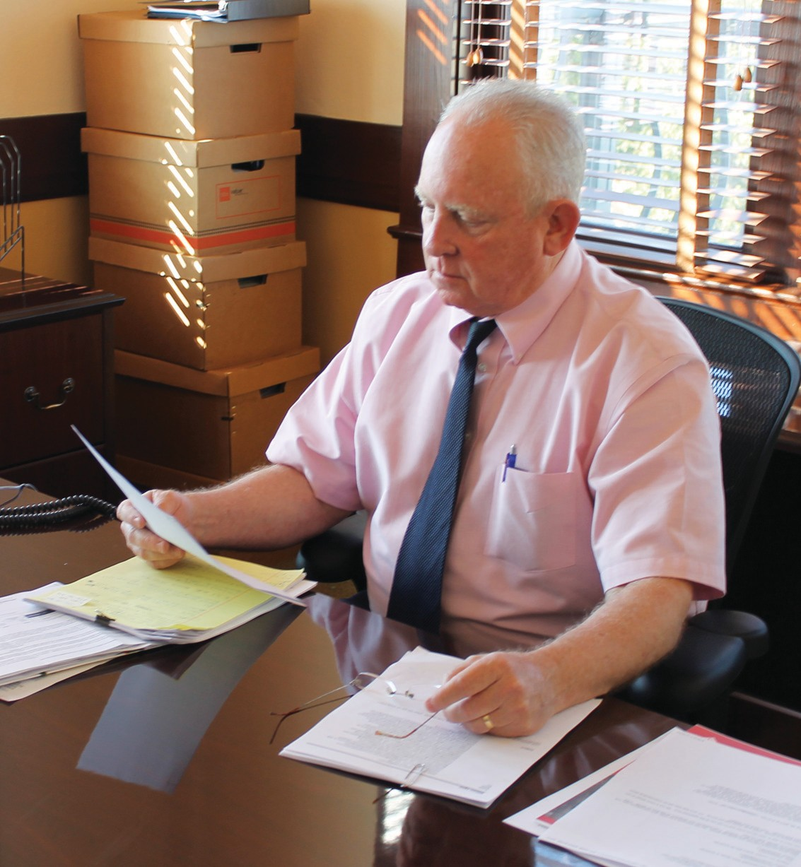 Judge Lynn Ellison at work in his new office as Court at Law Judge in the Atascosa County Courthouse.