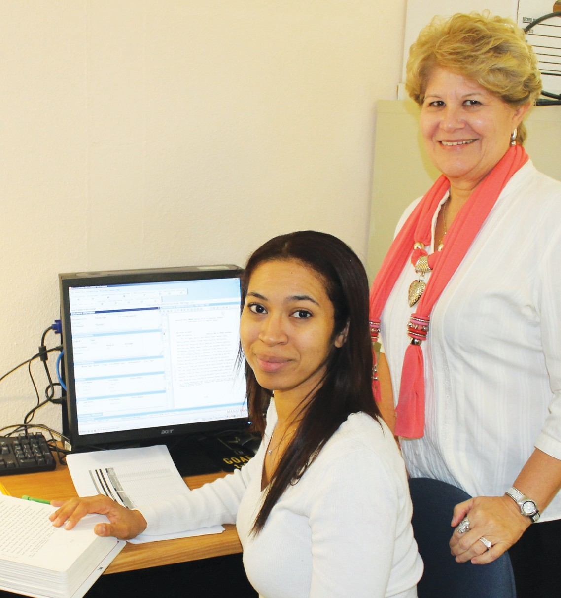 Carla Ozuna, third-year law student at St. Mary's University School of Law in San Antonio, going through the indexing and making sure the content is correct in records at the Atascosa County Courthouse files in the Countty Clerk's office. Looking on is Atascosa County Clerk Diane Gonzales.