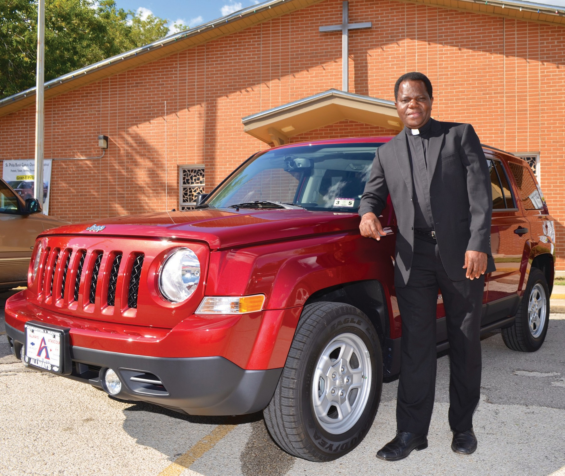 Father Albert Lelo is pictured with the Patriot Sport Jeep that will be raffled during the United Music Festival. He, along with the Festival Committee and the whole community of St. Philip Benizi Catholic Church, would like to invite everyone and their families to come out and show their support to this great event. Proceeds from this festival will go to the long awaited New Parish Hall Facility. No ice chests will be allowed on the grounds.
