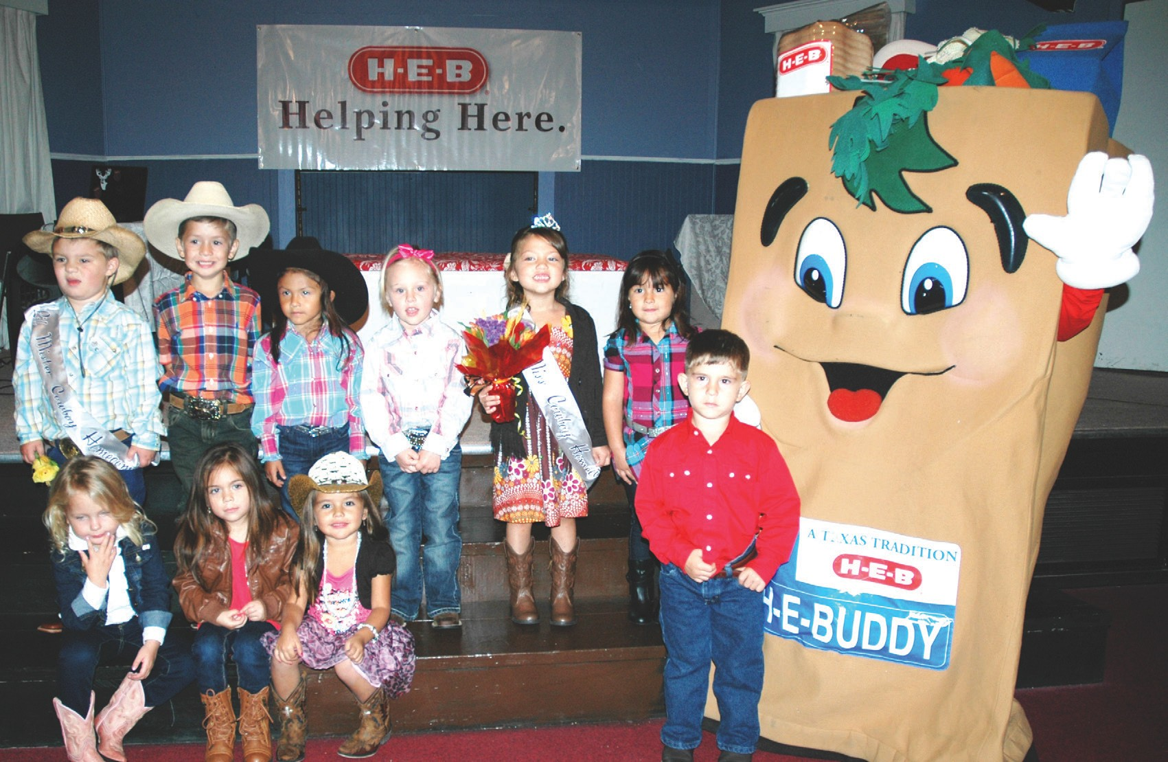 H-E-BUDDY gave out goodies to all the contestants of the Pleasanton Chamber of Commerce Lil' Mr. and Miss Cowboy Homecoming. Front row, left to right, are Grace Lageschulte, Lendon Garza, Maricela Lozano, and Kaden Holes. Back row, left to right are Lil' Mr. Cowboy Homecoming Killian Kaiser, Julian Ayala, Addison Gibson, Lillian Monzingo, Lil' Miss Cowboy Homecoming Laney Aguilar and Azana Sendejo.