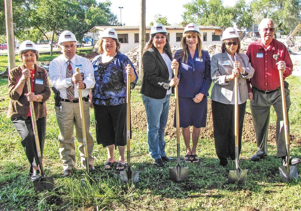 Preparing to break ground are the Atascosa Health Center Board of Directors. From left to right: Lillian Lyssy, Dwayne Villanueva, Tammy Favor, Lillian Cashmer, Melanie Wells, Maria D. Cruz and Wilbur Palmer.