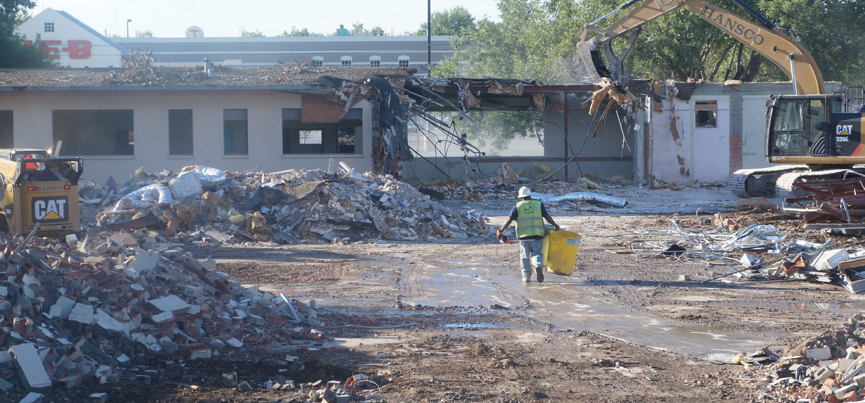 A crew demolishes the original Atascosa Health Center building on Oct. 17.