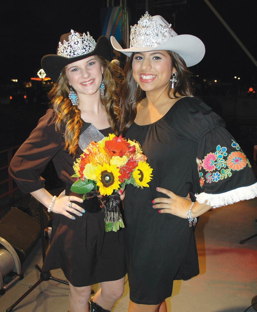 Oriana Ortiz (right) was crowned the 48th Cowboy Homecoming Queen at the coronation on Friday by 2012-13 Queen Kianne Rowinsky.