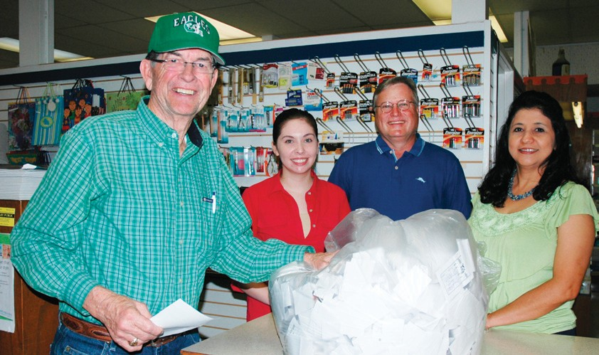 Elvin Stinson, left, is congratulated by the Center Pharmacy staff, Gabby Zuniga, Myron Repka and Silvia Martinez as the newest winner for Cowboy Crazy Cash. Stinson won a $500 shopping spree to be spent with the participating merchants. His name was chosen out of thousands of entries.