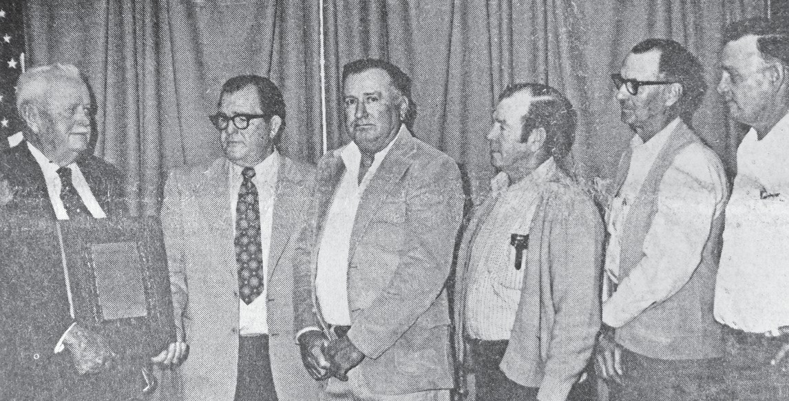 Halff Coward, sheriff of Atascosa County for 16 years and a deputy for four, was presented a plaque of appreciation by the county commissioners Monday. Left to right are Ex-Sheriff Coward, County Judge David Davidson and Commissioners Buford Wilson, Bill Westbrook, Cecil Bynum and Smith Tausch. Express photo originally published in the December 12, 1973 edition.