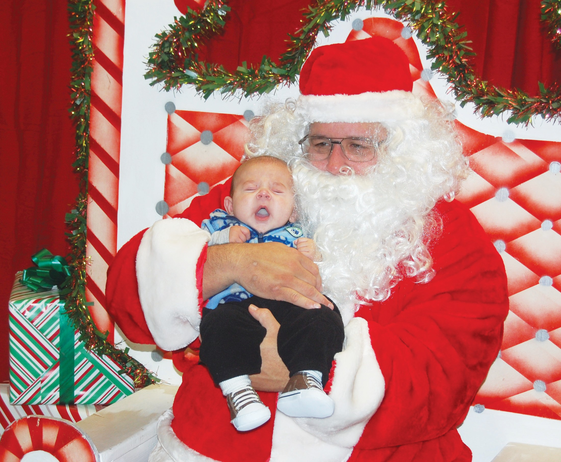 Little Arkaidian Partida was too sleepy to smile for the camera with his photo with Santa at the Jourdanton Library on Monday. Santa heard the wishes of lots of boys and girls at the annual event. Arkaidian is the son of Stephanie and Arnold Partida of Jourdanton.