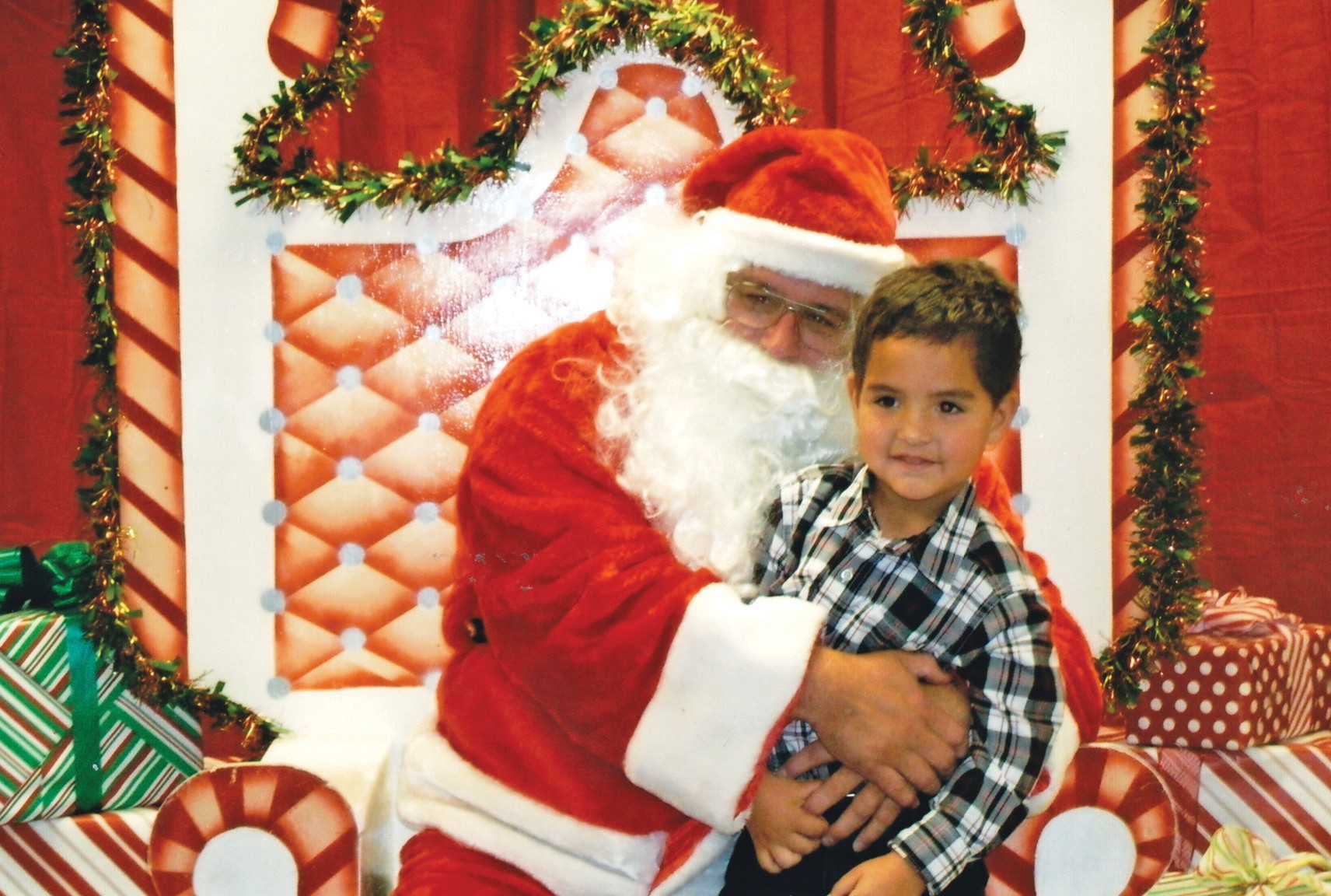 Wesley Okrahlik, 4-year-old son of Ashley and Frank Okrahlik, was able to tell Santa what he wanted at the Jourdanton Library this past Monday evening.