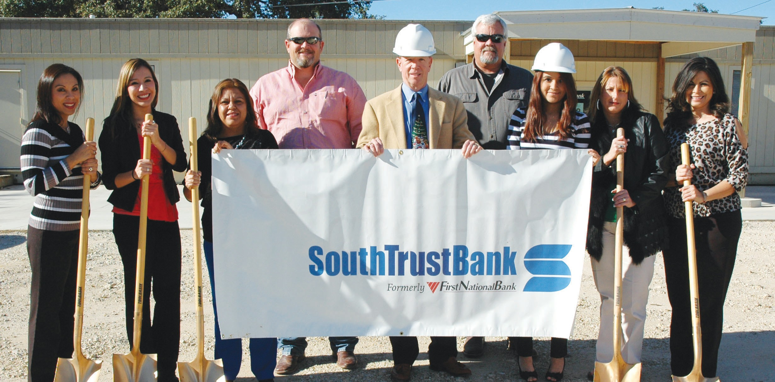 South Trust Bank (formerly First National Bank) held their groundbreaking ceremony recently. Construction for the full service bank – a 5,600 square foot building with four drive through lanes and ATM – will begin soon with Wells Construction as the contractor. Left to right are Lisa Contreras, Sabrina Casares, Irma Martinez, Jess Kemp, Wells Construction; Wade Hodgin, South Trust Bank President; Roger Wells, Wells Construction, Ashley Talamantez, Pandy Salinas and Tillie Ambriz.