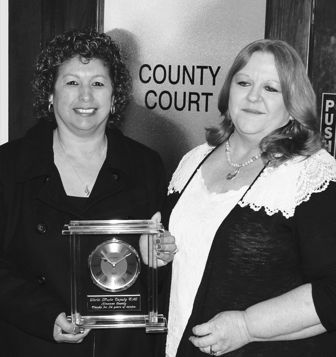Gloria Mejia, left, receiving retirement plaque from Atascosa County Tax Assessor-Collector Loretta Holley. Gloria had served as a Deputy Tax Assessor-Collector for a total of 34 years. She served in that position from November 7, 1977 to September 30, 1989 (12 years) and later from February 25, 1991 to December 31, 2013.