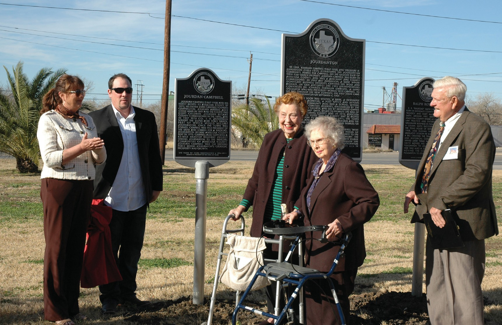 Descendants of Jourdan Campbell, Roxanne and her son August Peters (from left) unveil the newest historical marker at the dedication ceremony held in conjunction with the grand opening of the new Jourdanton Municipal Complex. Jourdine Tymrak and Lillian Wiede, longtime residents of Jourdanton join in the celebration along with Norman F. Porter Sr., Chairman of the Atascosa County Historical Commission.