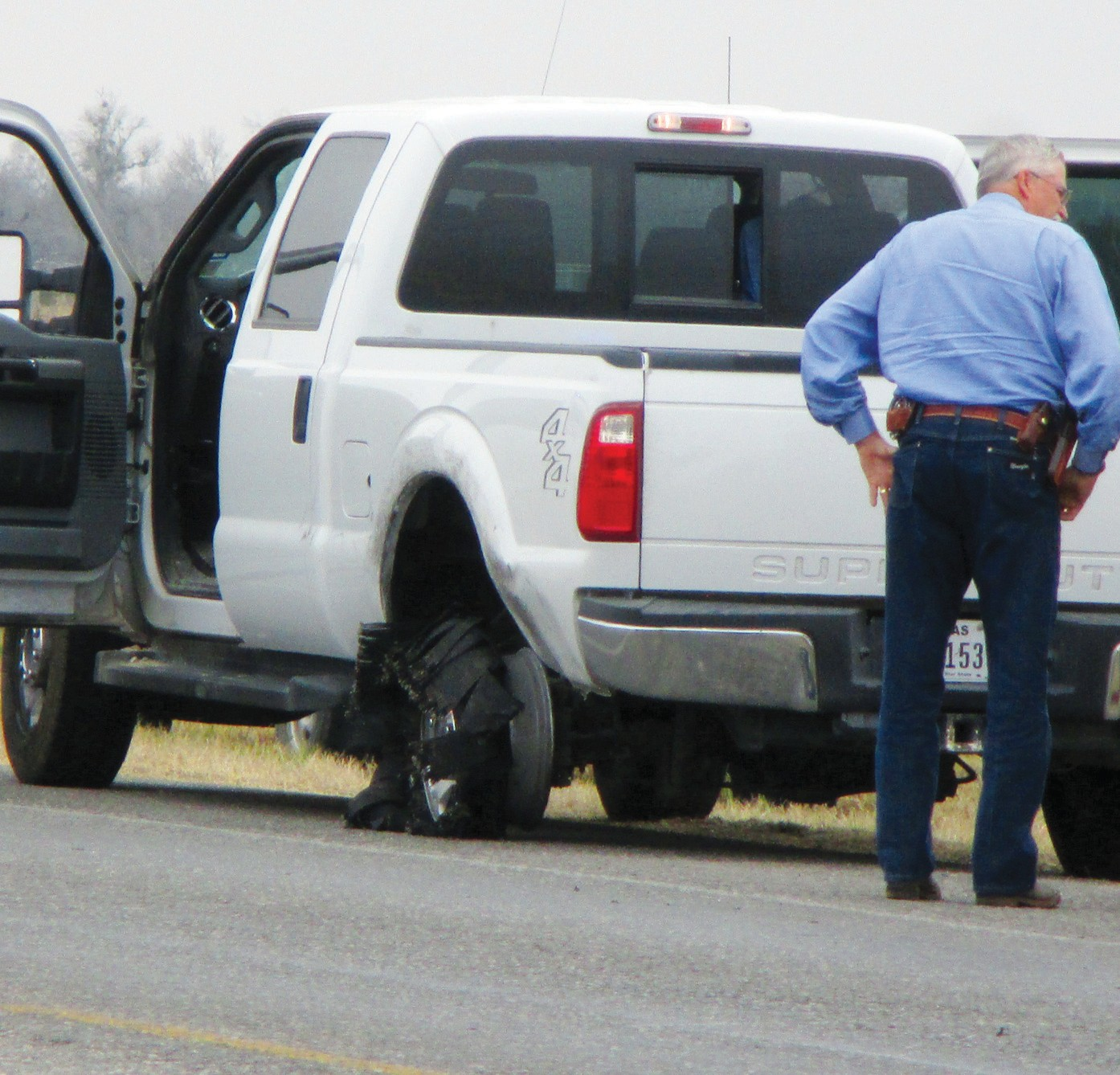 Atascosa County Constable Bill Meadows stands next to the 2014 Ford truck that Juan Nieto Chapa, 27, allegedly stole from its owner's yard on February 19 in Pleasanton.