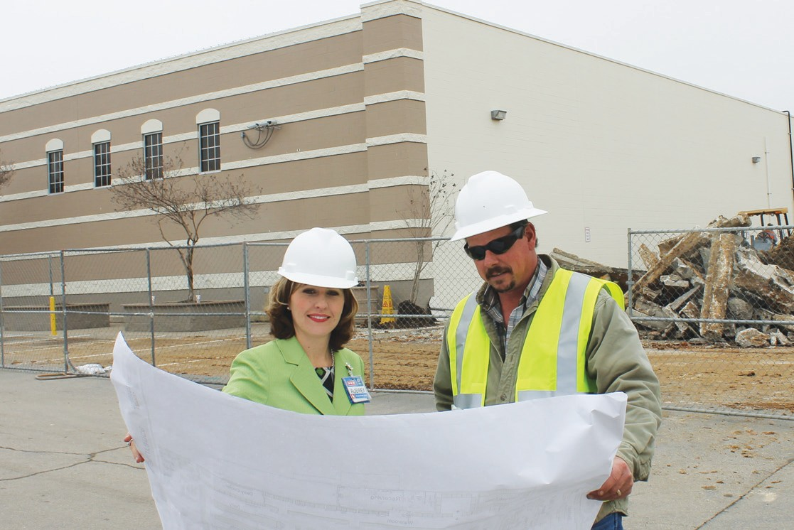 H-E-B Unit Director, Aubrey Smith, reviewing enlargement plans for the store with Construction Superintendent Scott Sutherland of TBC Commercial Construction, LLC, at the west side of the store where site leveling is being done.