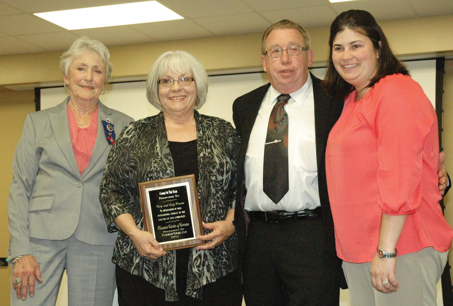 Patsy Troell (left) of the Pleasanton Woman's Club presented the Couple of the Year award to Judy and Gary Greene. Chamber 2nd Vice President Candace Trevino (right) assisted.