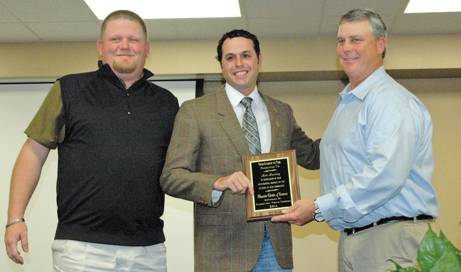 Matt Martinez was awarded Young Citizen of the Year at the Pleasanton Chamber banquet. Wade McBee, (left) representing the Pleasanton Young Farmers,(right) presented the award with Chamber President Chico Cox assisting.