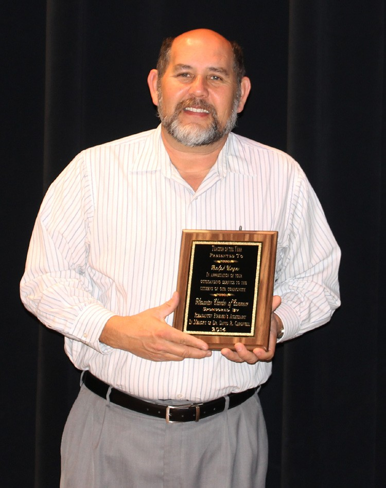 Ralph Unger was awarded Teacher of the Year at the annual chamber banquet. The award was sponsored by the Pleasanton Firemen's Auxiliary and presented by Margie Mendez.