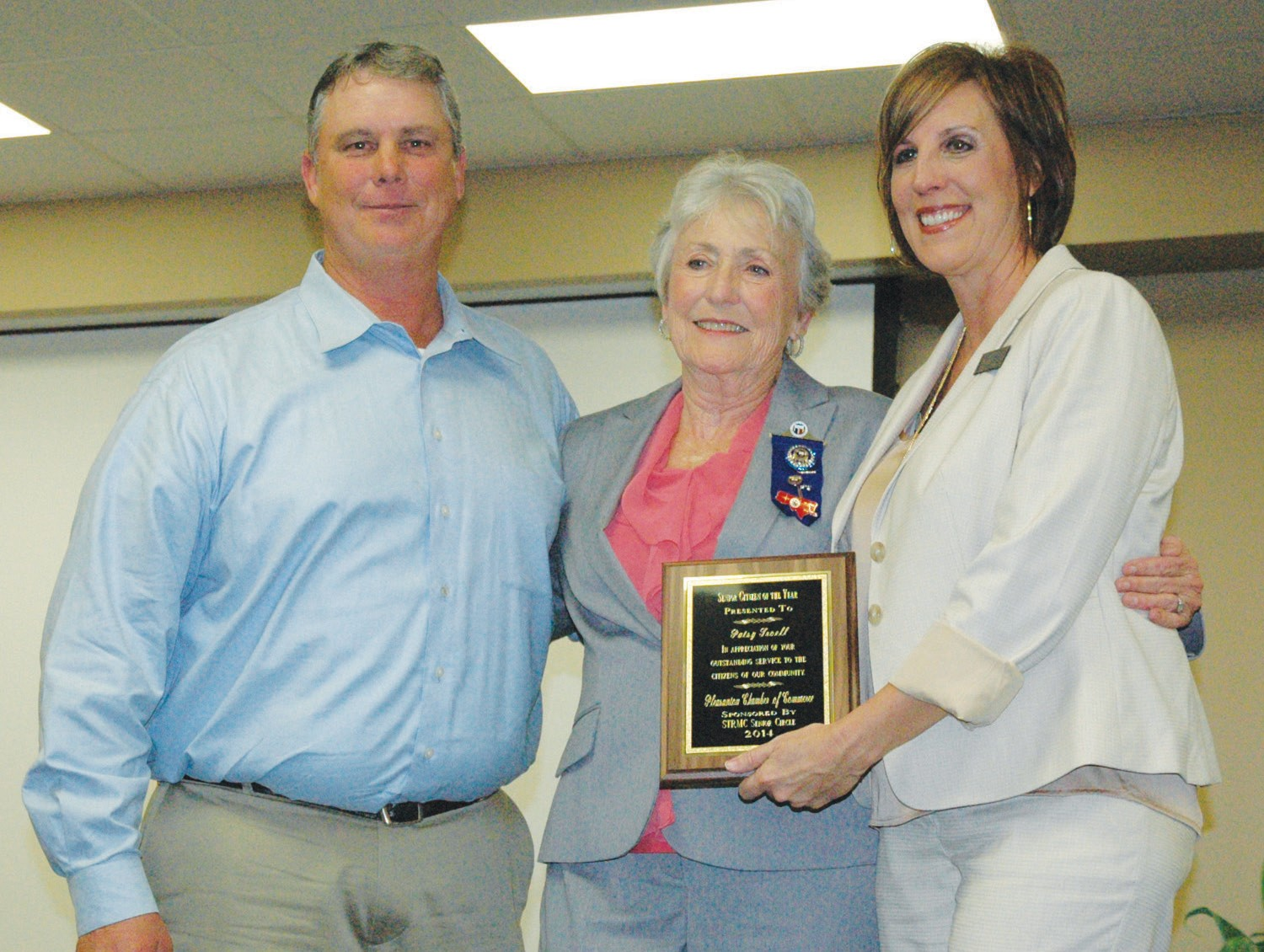 Patsy Troell, center, receives the Senior Citizen of the Year award from Chico Cox, representing the STRMC Senior Circle and his wife Chamber Secretary Pat Cox.