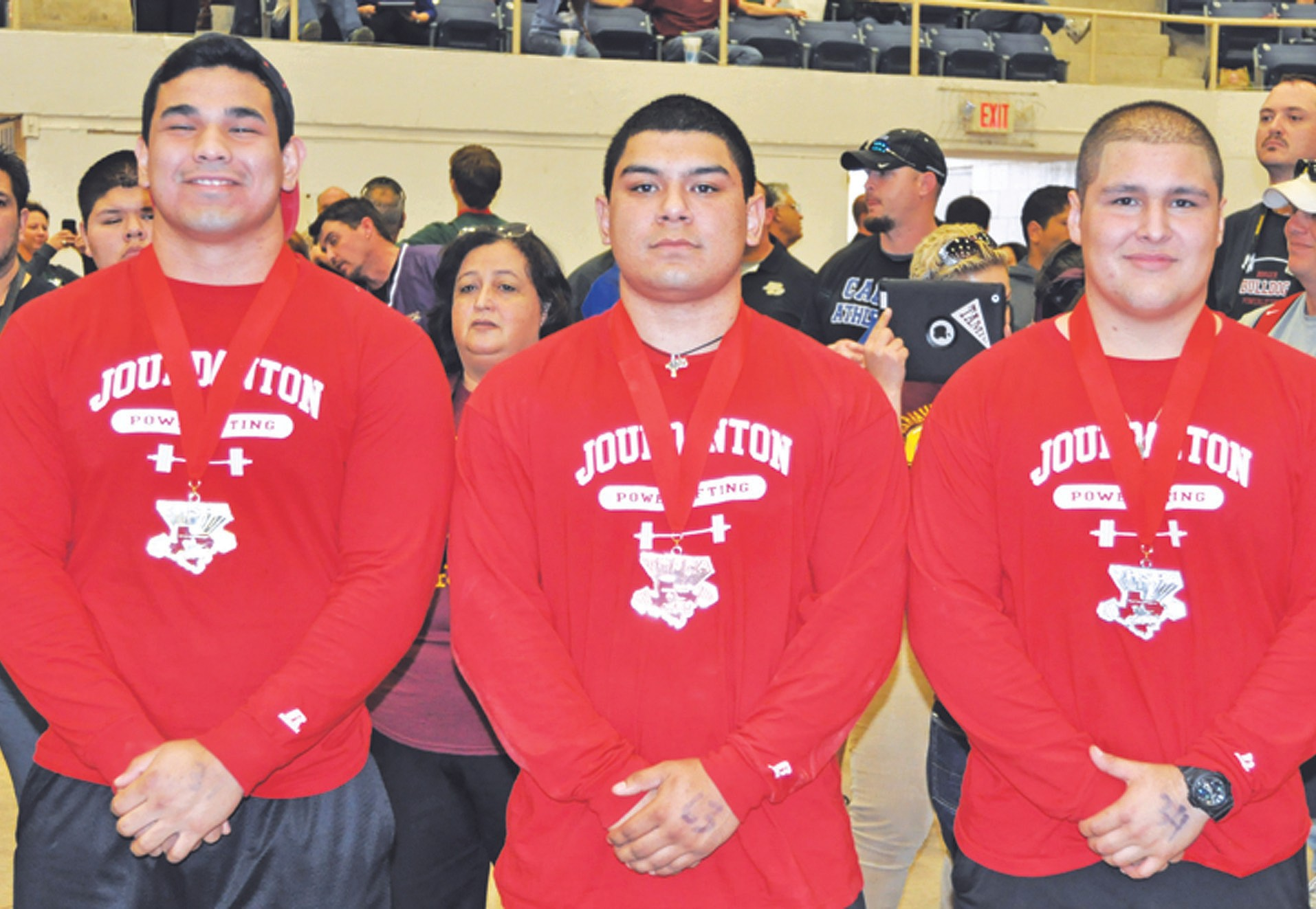 STATE CHAMPS: Jourdanton trio Enrique Lugo, Joe Estrada and Marc Boconegra pose for a photo after winning overall as a team in Division 3 at the state powerlifting meet in Abilene.