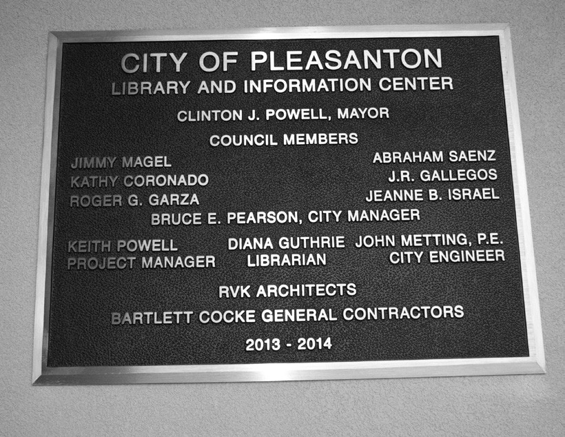 The plaques outside of the doors on the main (west) entrances of the Civic Center and the Library and Information Center greet all of those who enter.