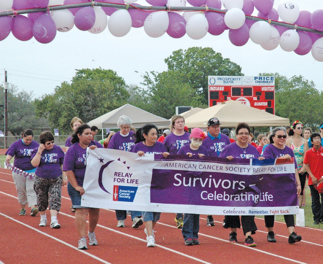 The Relay For Life Survivor Lap included, left to right (with banner) Rachel Flores, Odell Vasquez, Annalise Craig, Angie Bazan, and Annie Contreras. Back row are Kara Luna, (unknown), Liz Royal,Ann Roeder, J. C. Evans and Craig Dowdy.