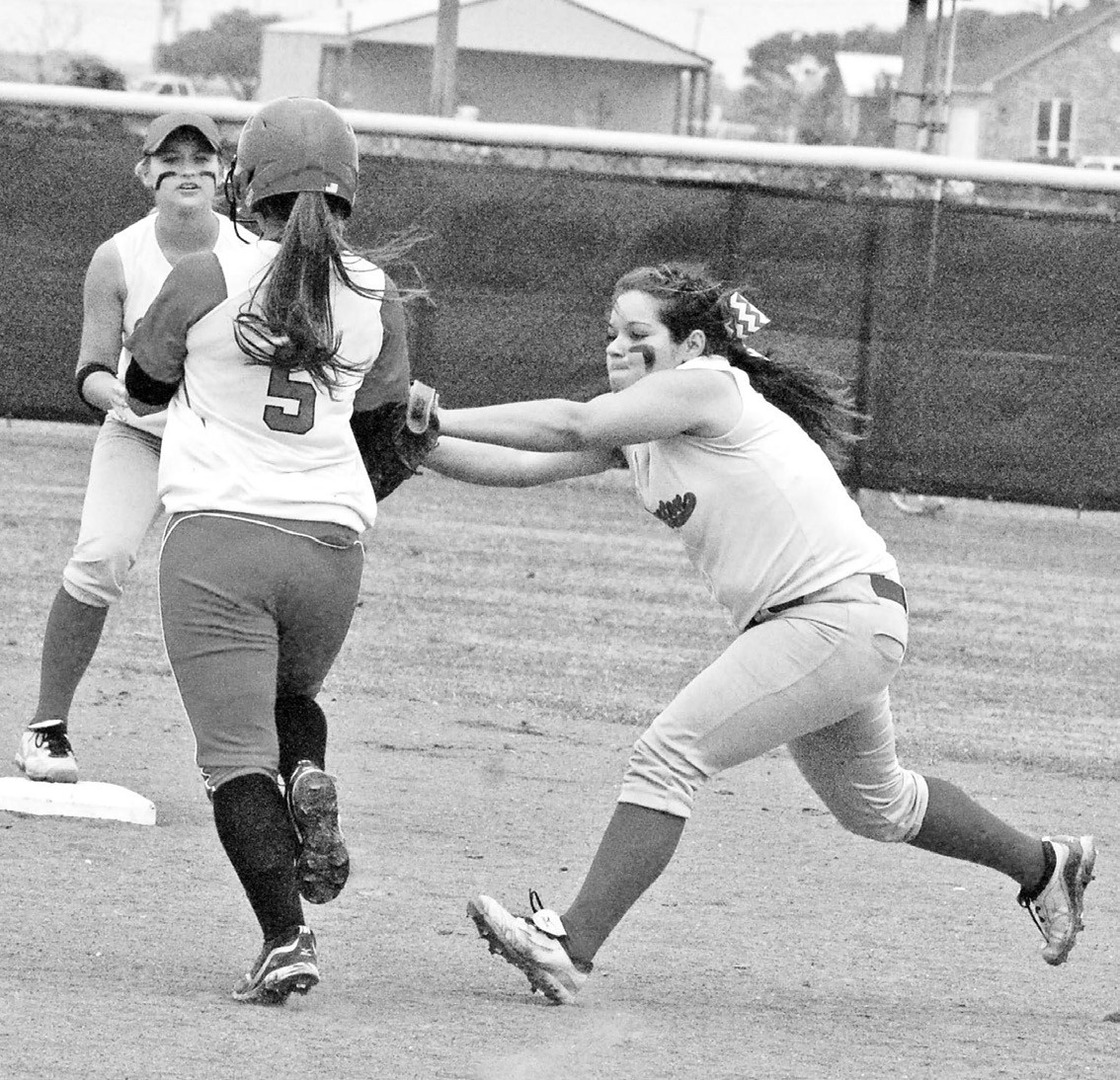 Jourdanton's Katherine Ramirez tags out an opponent running to 2nd base. The Squaws won 14 to 2 in Bi-District round against Palacios.