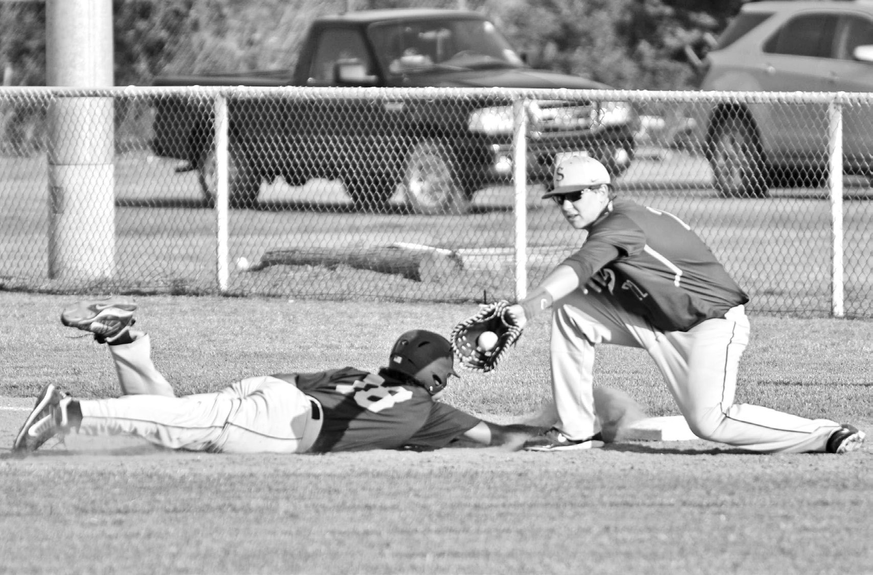 Charlotte junior James Deleon slides safely back to 1st after attempting to steal a base last week against Sabinal. The Trojans won 8-0 and improve to 20-3 overall.