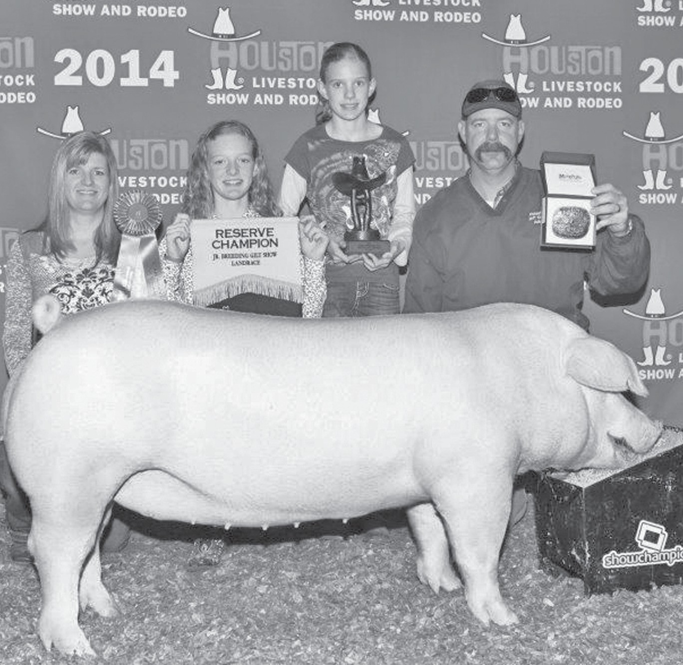 Jayci Kennedy (holding banner) exhibited the Reserve Grand Champion Landrace Breeding Gilt at the Houston Livestock Show. Jayci is a 7th grader at Poteet Junior High and is the daughter of Jeff and Stacey Kennedy, also pictured is her little sister Kayli. A special thank you goes out to Heffernan Genetics where the gilt was purchased from. She also placed 2nd at the Atascosa County Livestock show and 3rd at San Antonio Livestock show.