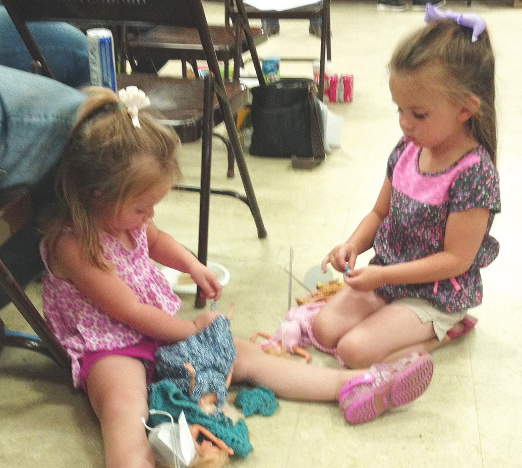 """These cute little dolls, Kenzie (left) and Alexis Rakowitz had a great time playing with their """"new"""" Barbies® at the St. Andrew BBQ Picnic and Auction this past Sunday. Their parents, Nicole and Walt Rakowitz, won the bid on the vintage dolls with the crocheted dresses by Bertha Garza."""