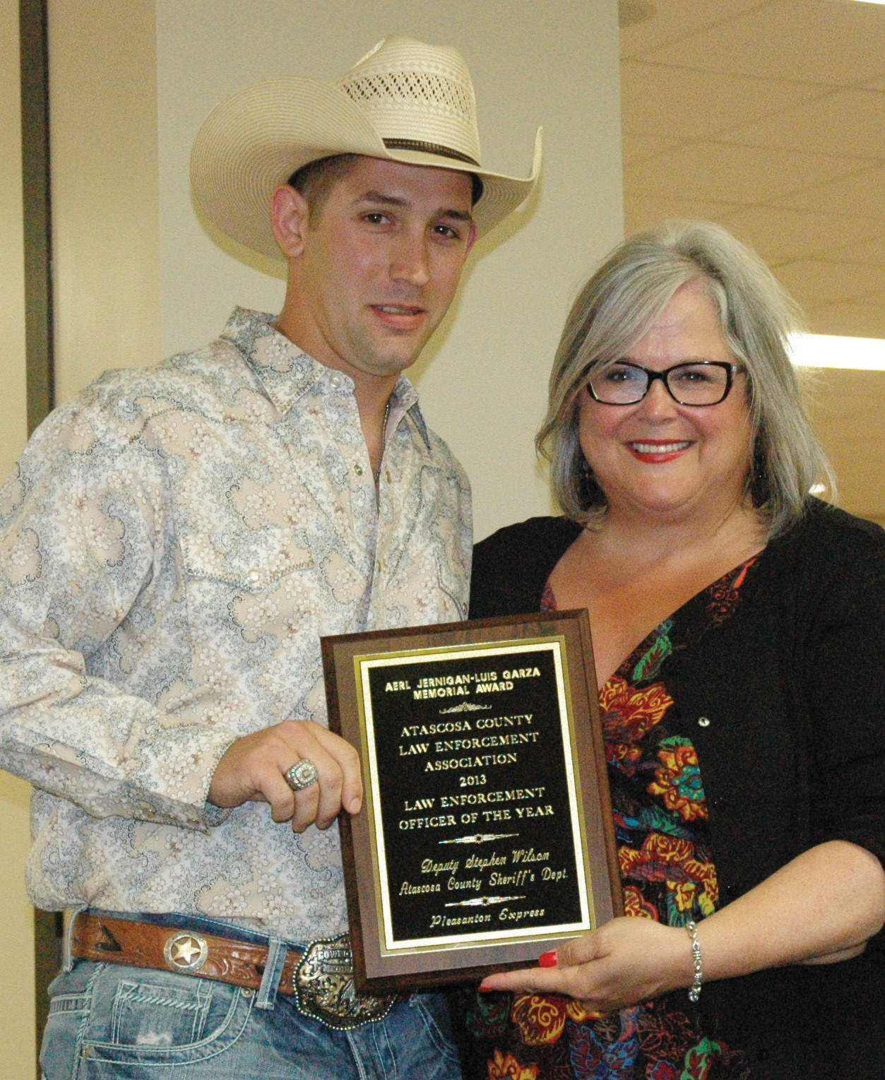 Atascosa County Sheriff's Deputy Stephen Wilson is awarded ACLEOA Law Enforcement Officer of the Year by Pleasanton Express editor Sue Brown at the annual awards banquet held Friday, May 23.