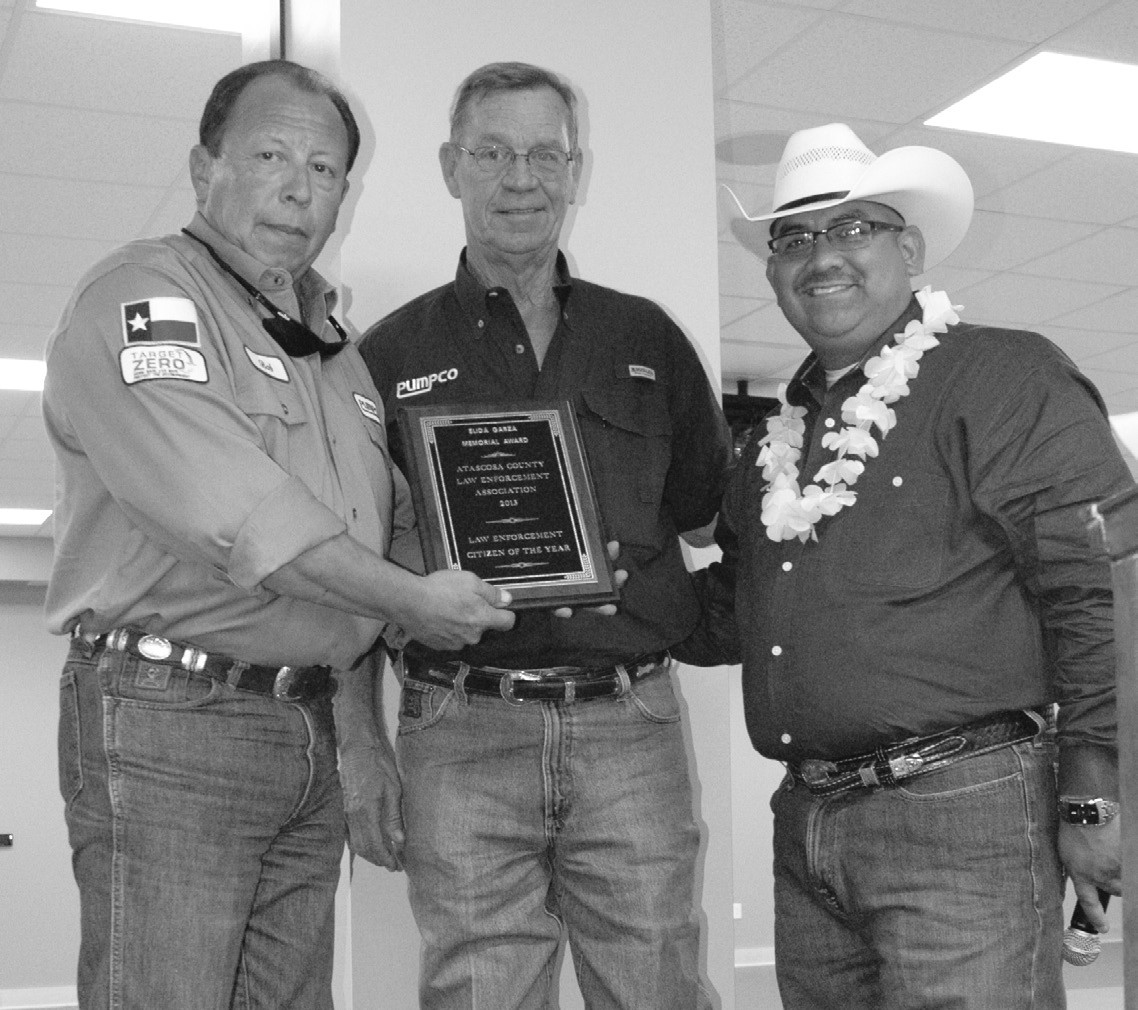 Pumpco Energy Services was awarded the Citizen of the Year for their continued support of ACLEOA. Receiving the award are, from left, Bob Bratten, Jr. and Tommy Crouch from ACLEOA President Albert Garza.