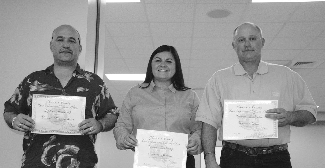 Receiving certificates for Lifetime Membership status are left to right, San Antonio Police Officer Daniel Higgenbotham. Sgt. Norma Jordan and Lt. Investigator Wayne Stratton both of the Atascosa County Sheriff's Office.