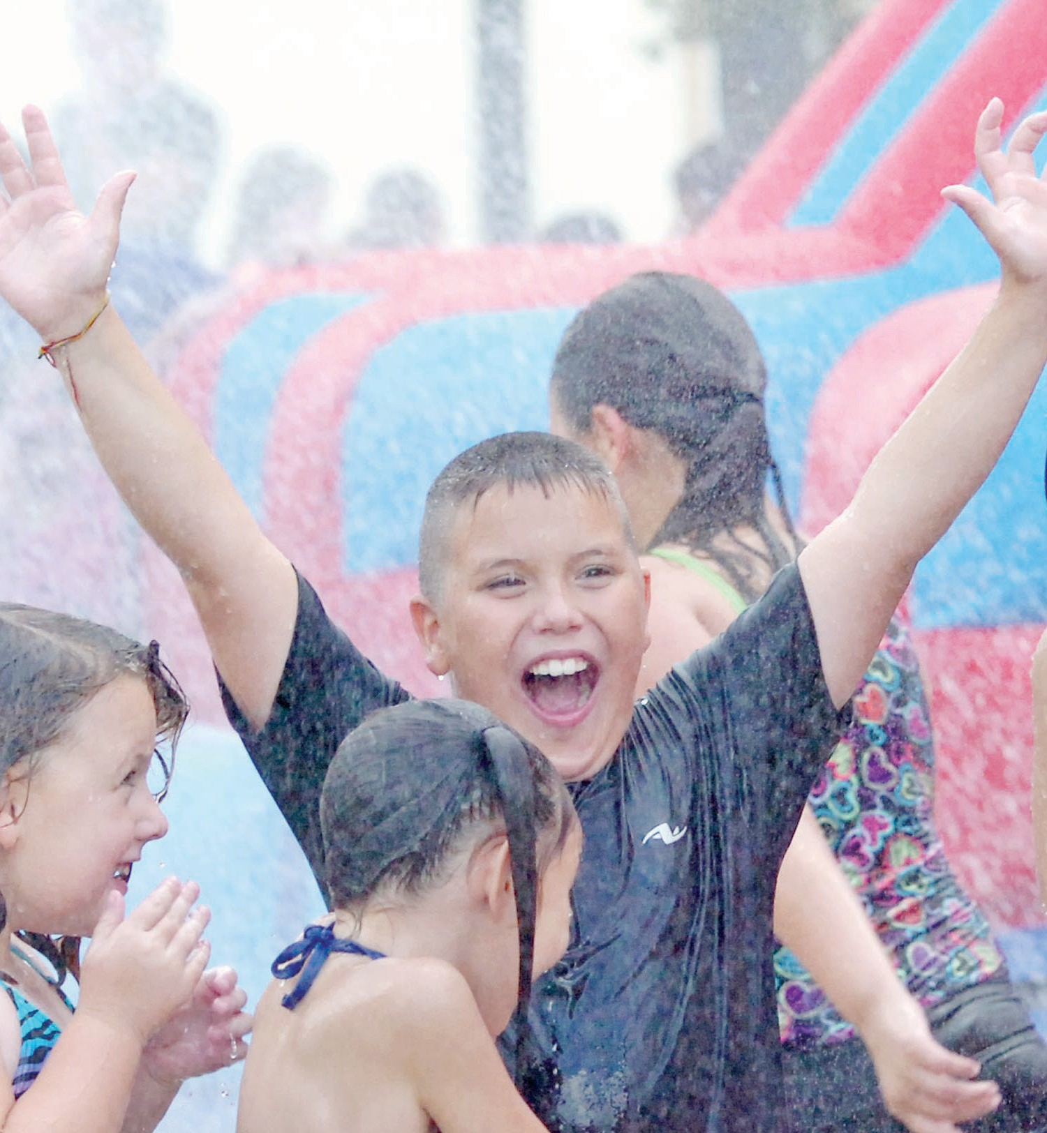 Brandon Morales of Pleasanton shows his joy while playing in the water during a water day at First Baptist Church in Pleasanton.