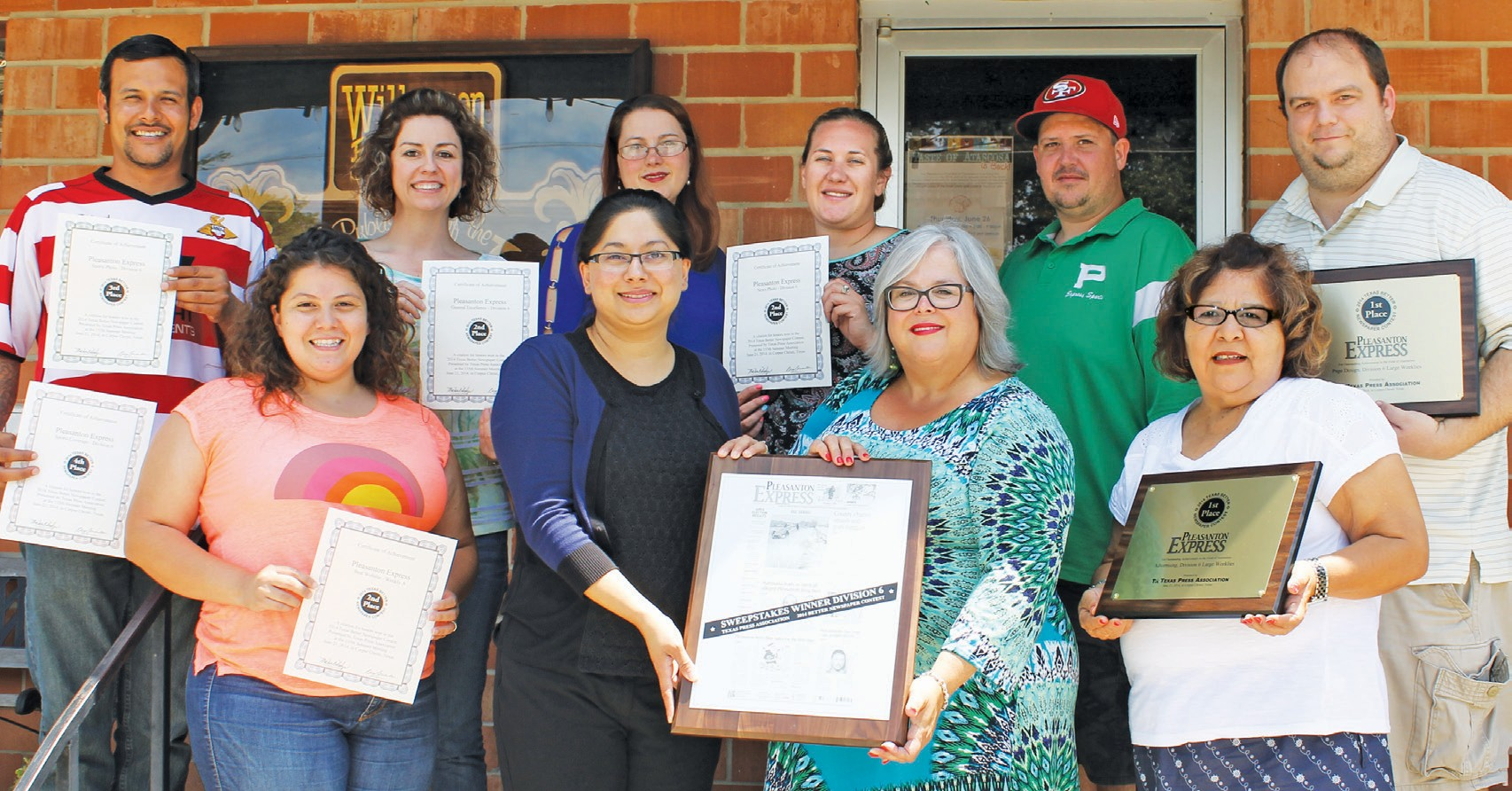 Left to right are some of the award-winning staff of the Pleasanton Express. Texas Press Association Better Newspaper Contest awarded Sweepstakes to the paper at the Leadership Retreat held last weekend. Pictured with their awards are, left to right, front row: Jessica M. Machado, Lisa Luna, Sue Brown and Hope Garza. Top row are Chris Filoteo, Robbie Hamby, Rhonda Chancellor, Megan Benishek, Aaron Davidson and David Wickersham. Missing are Mary Gallegos, Noel Wilkerson Holmes, Leon Zabava and Maggie Rodriguez.