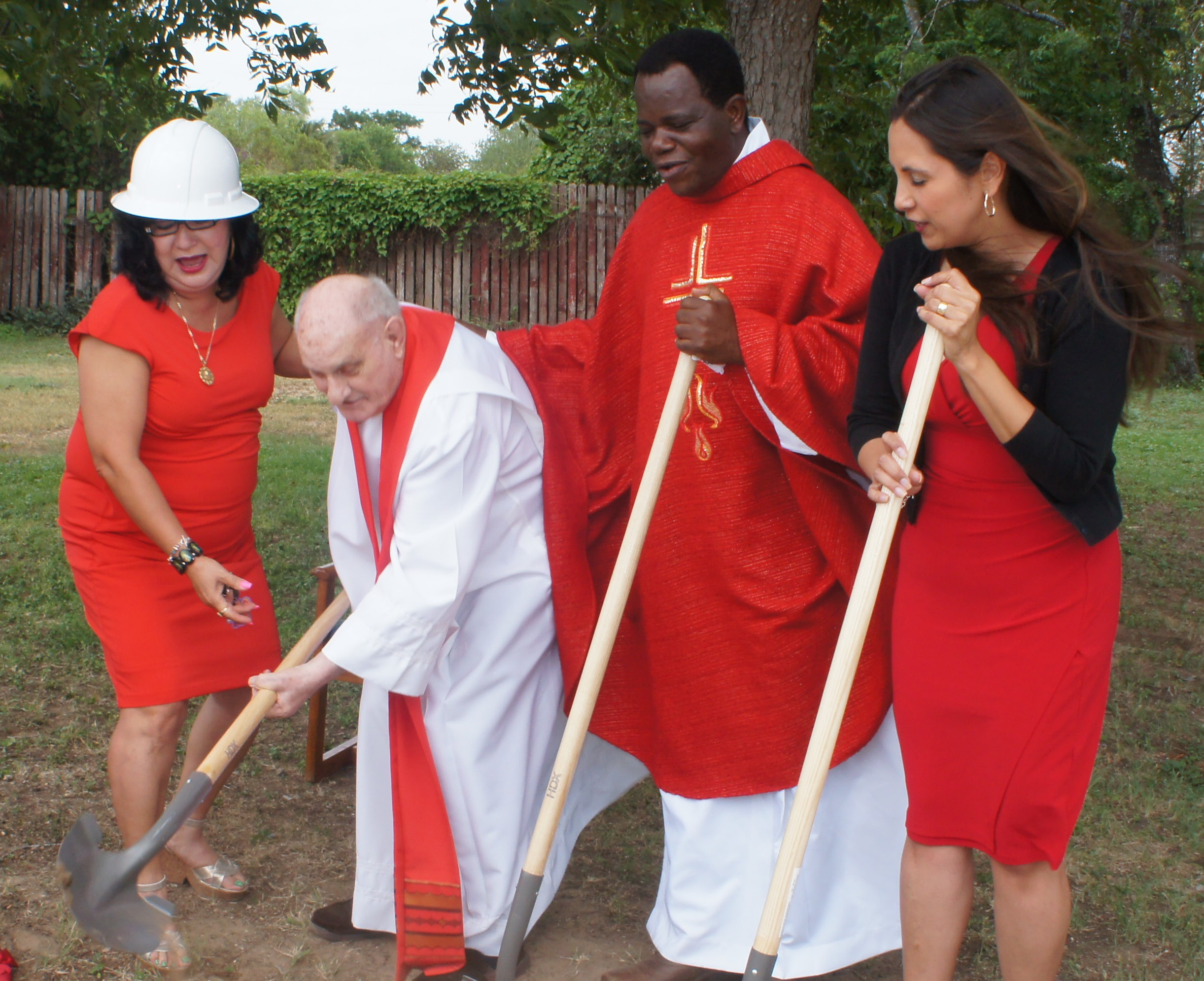 The parish at St. Philip Benizi Catholic Church in Poteet celebrated the ground-breaking of a new parish hall. Among those taking part in the occasion are, left to right: Virginia Estrada, Father Felix Avau (retired priest), Father Albert Lelo (current priest) and Anna Ybarra.