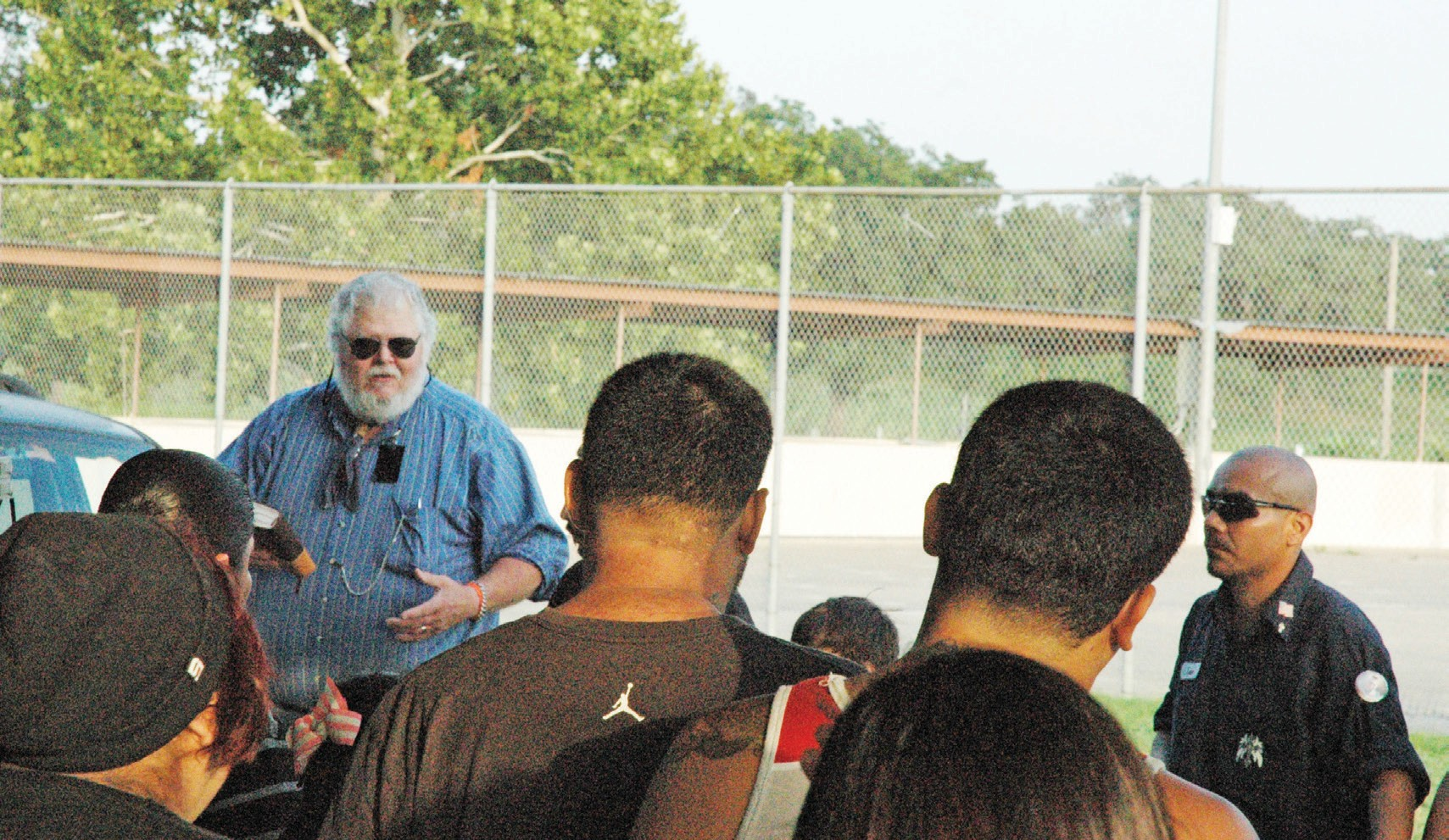 Kenneth Montgomery (left) offers prayers and comforting words to the families and friends of those who were killed and those who are still missing. Coordinator for the the event was Louis Coronado (far right), uncle of slain victim Daniel Coronado Jr.