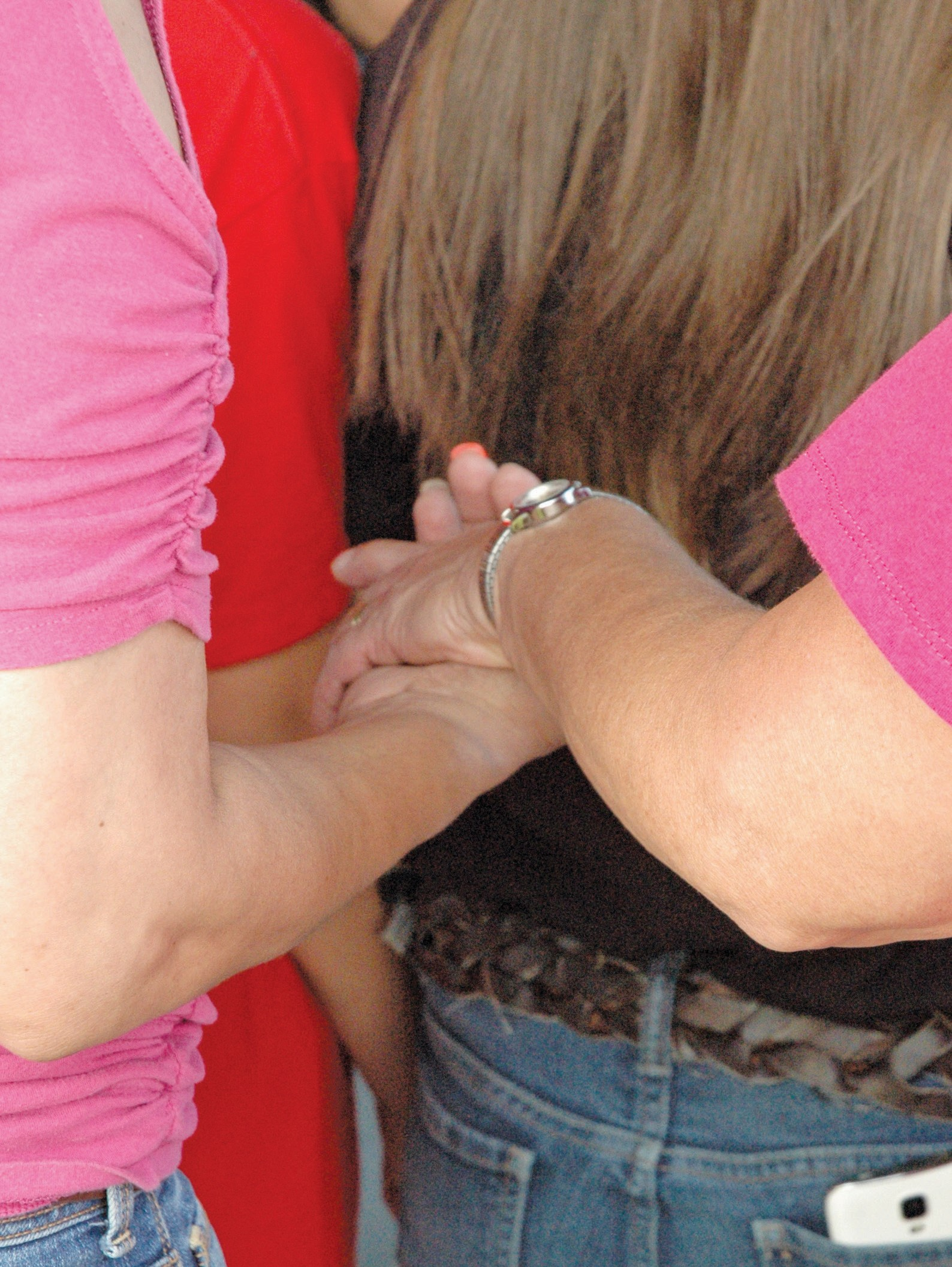 Hands were held during the vigil for lost lives and missing persons.