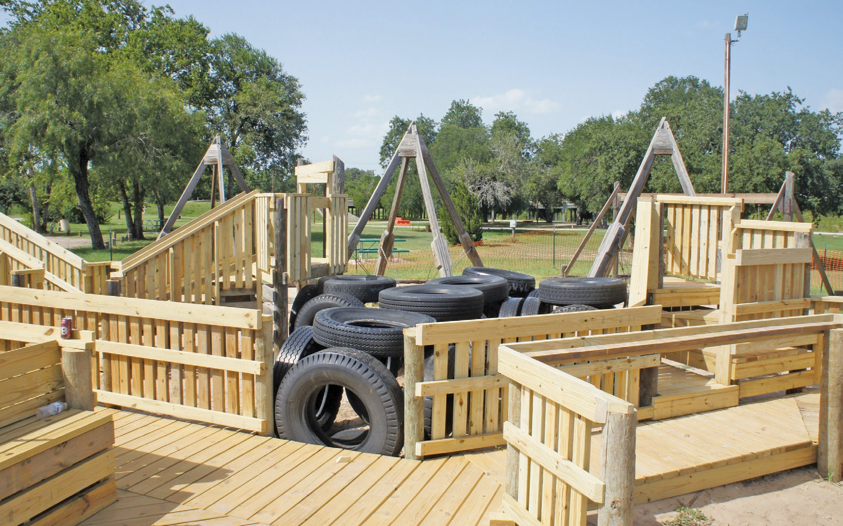 The reconstruction of the playscape at the Atascosa River Park in Pleasanton continues, by Robert Garcia and crew. The newly reconstructed portions of the playscape strike a contrast between the older wood in the background.