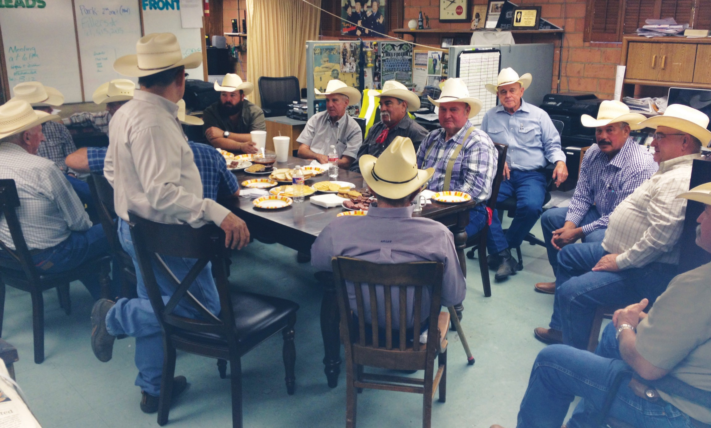 Each year former Cowboys of the Year meet at the Pleasanton Express to choose the next recipient as well as the new inductees into the South Texas Cowboy Hall of Fame. Sixteen made it to the meeting and gathered around the table. From bottom right, clockwise are Leroy Krueger ('00), Tommy Henry ('86), Chairman Joel McDaniel ('90), David McDaniel ('97), Robert Bryan ('84), Roy Hindes III ('04), Benny Zuniga (91), Clint Hindes ('01), Johnny Schrutka ('05), Roy Alonzo ('13), Charles Maddox ('87), Billy Wayne Kaiser ('07), Gilbert Gonzales ('92) and David Kaiser ('09). Out of camera shot were Darryl Ashley ('94) and Mickie Clark ('03).