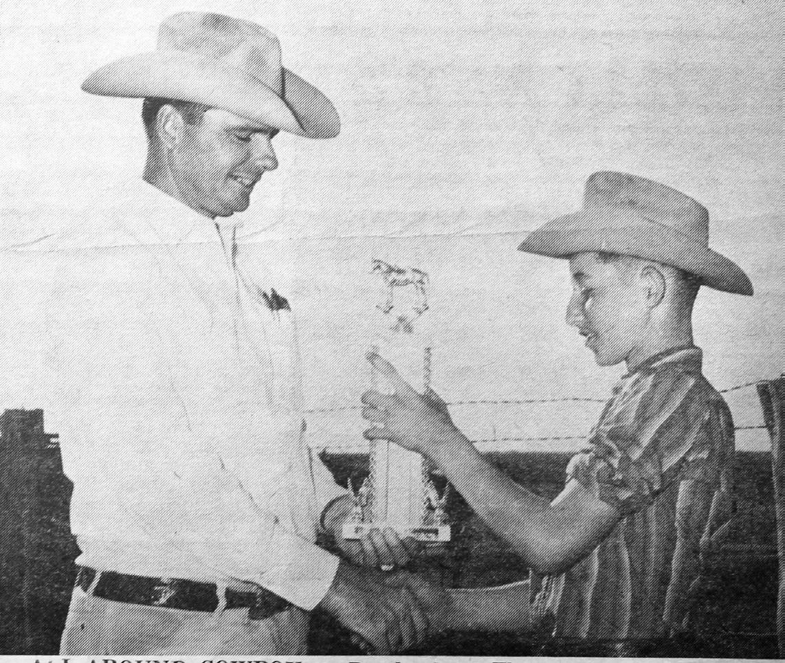 Randy Mangum of Poteet is being presented a trophy as allaround cowboy of the first annual Atacosa County Junior Horse show, by Bob Hindes, show superintendent. The award came on the basis of most points collected overall in various horse contests held Saturday afternoon at American Legion Park Rodeo arena.