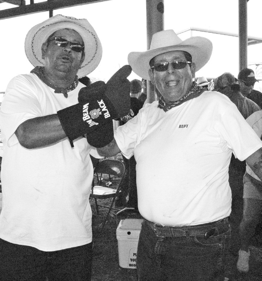 """Fun loving siblings, Rudy and Lupe Martinez of the Two Brothers barbeque team celebrated coming in last in two divisions - ribs and brisket - with their prize of cooking gloves. """"We lose really good - but we always have fun,"""" said the older brother Lupe (right)."""