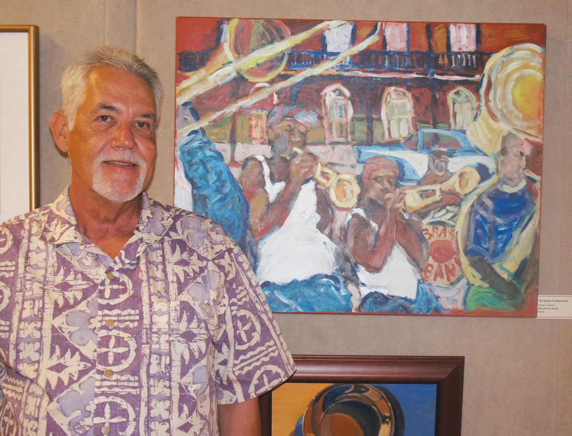 "Artist Steven G. Smith is shown with his artwork, ""The Saints Go Marching."""