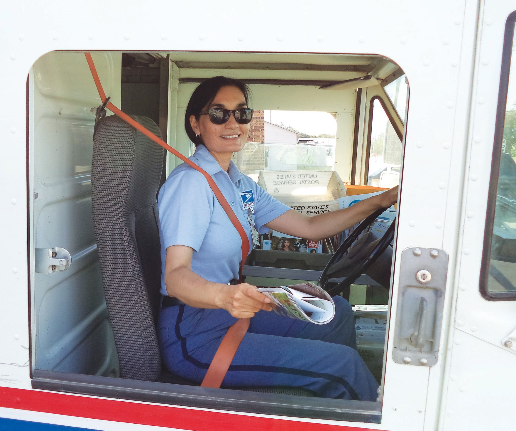 Josie Martinez, a U.S. Postal Service letter carrier in Jourdanton, was recognized for her safe driving by receiving the Million Mile Club plaque from the National Safety Council. Martinez has driven her route accident free for 30 years.