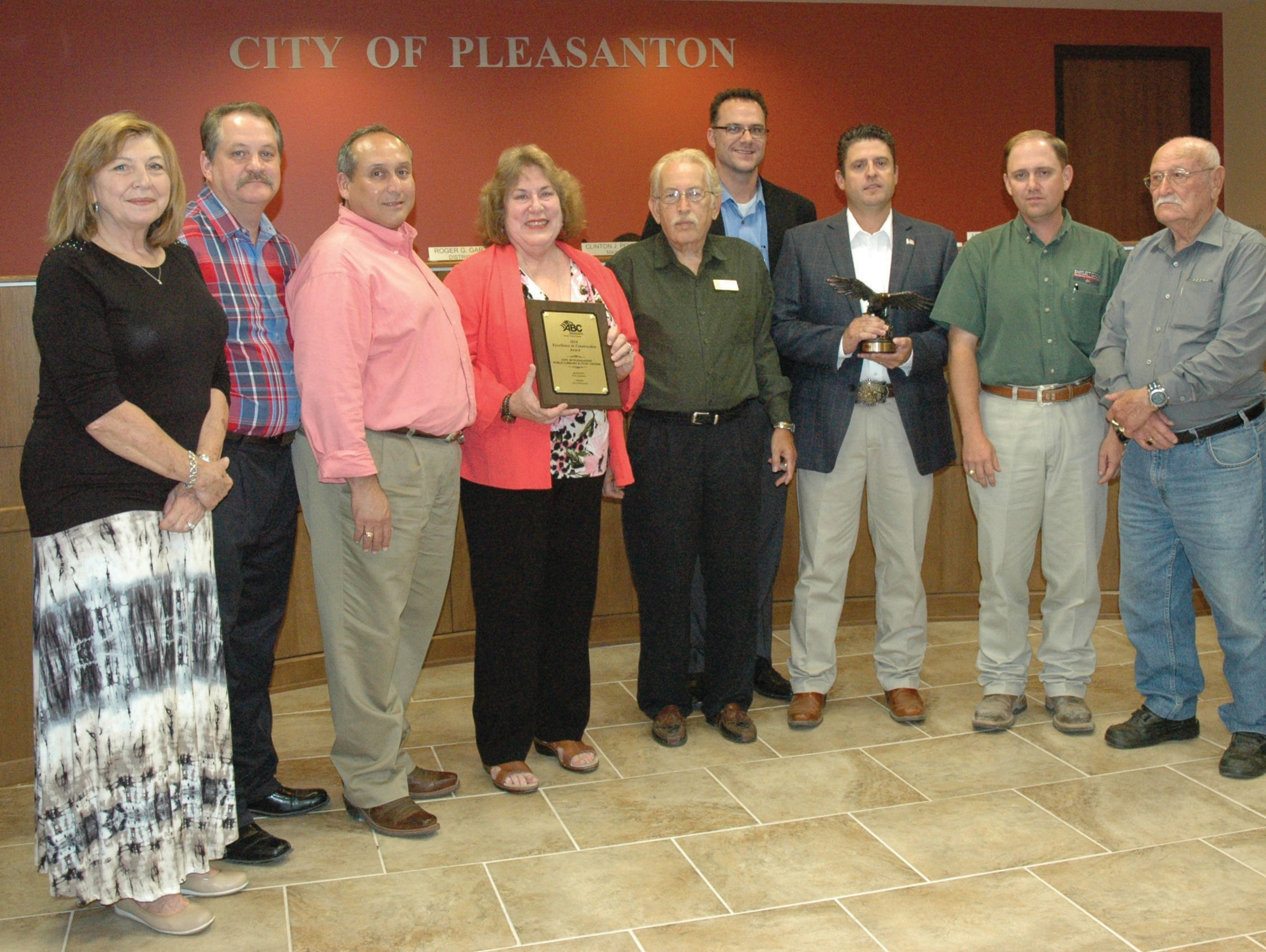 Pleasanton Mayor and City Council received the Associated Builders and Contractors, Inc. - South Texas Chapter's Historic Restoration - Projects valued $2-10 million award at the September 4 meeting. Bartlett Cocke General Contractors, with the assistance of RVK Architects, nominated the Pleasanton Civic Center, Public Library and Freedom Center project. Receiving the awards are, left to right, Diana Prasifka, District 3 Councilmember; Douglas Best, District 1 Councilmember; J. R. Gallegos, District 4 Councilmember; Jeanne Israel, District 6 Councilmember, Roger Garza District 5 Councilmember, Heath Wenrich, LEED AP RVK Architect/Principal; Mayor Clint Powell, James Caraway, LEED AP Bartlett Cocke Project Manager and Abraham Saenz District 2 Councilmember.