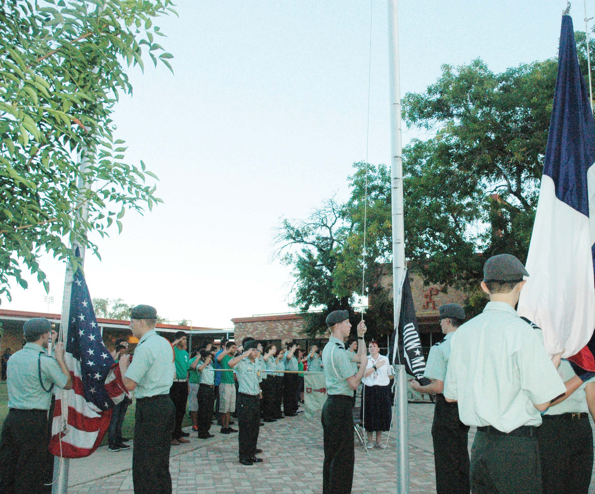 JROTC Cadets prepare the United States, POW/MIA and Texas flags to be flown at half-staff during the Patriot Day ceremony on September 11 at the Pleasanton High School.