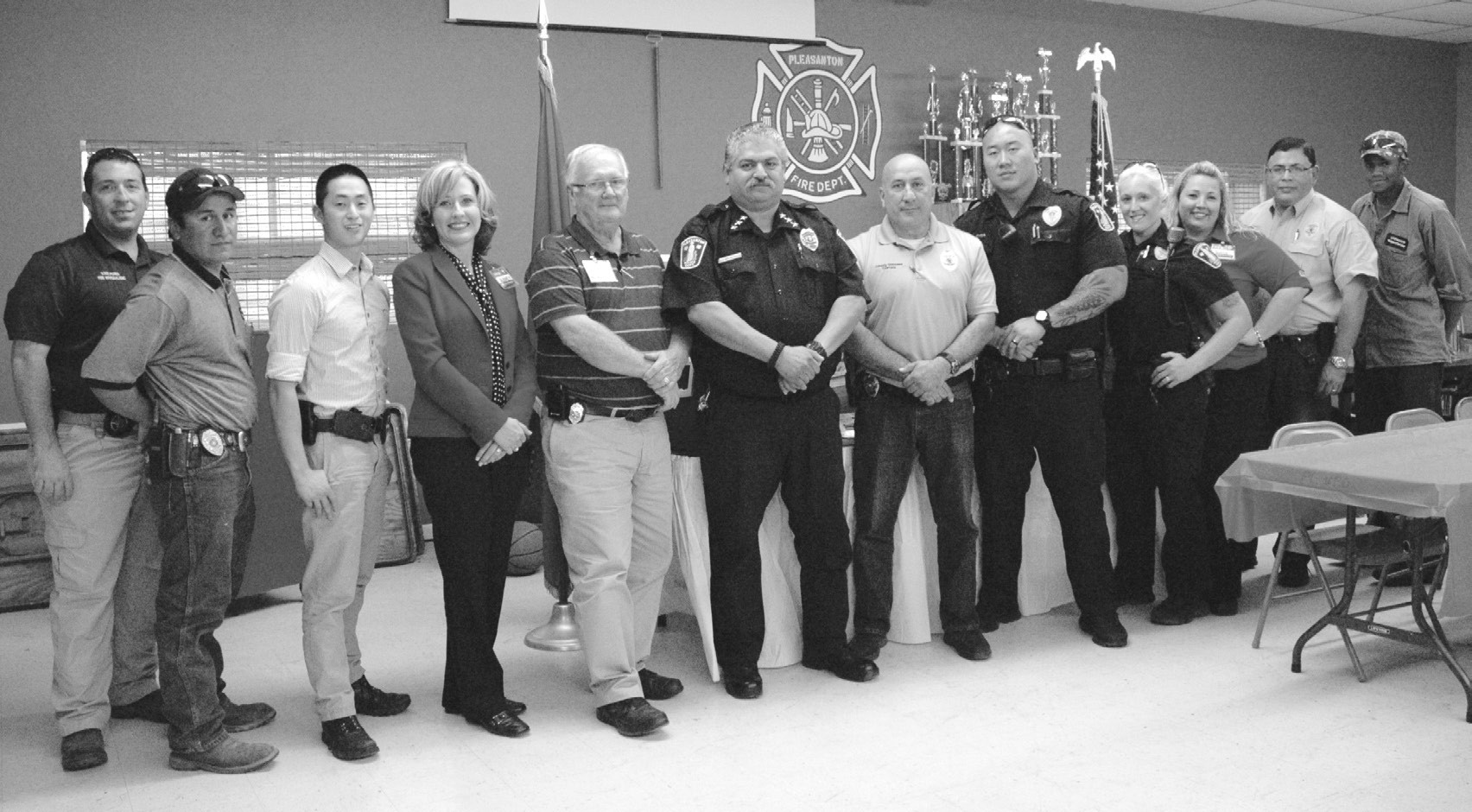 Pleasanton H-E-B honored members of the Pleasanton Fire Department and Police Department on the anniversary of 9/11 with a luncheon and ice chests filled with snack items during their annual Helping Heroes project thanking first responders for their service. Left to right are, Todd Perna, Atascosa County Emergency Management Coordinator/Fire Marshal; Jorge Quiroga, firefighter, Investigator Seth Trussell, Aubrey Smith, H-E-B Unit Director; Fire Chief Chuck Garris, Police Chief Ronald Sanchez, Capt. Johnny Gonzales, Officer Tzu- Chia, Officer Jessi Chia, Tanya Huff, H-E-B Assistant Store Director; Lt. Noe Rodriguez and Sheldon Murray, fire fighter.