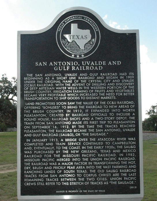 The newly installed Texas Historical Markers commemorating the SAU&G Railroad and North Pleasanton may be seen at the corner of First Street and Spur 242 (Commerce Street) east of the bridge and tracks.